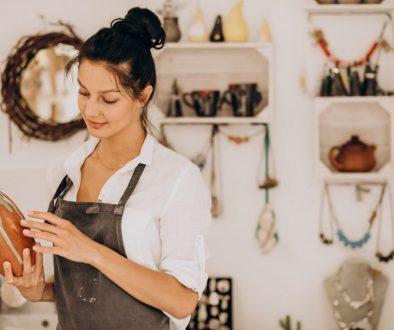 Woman craftmaster at a pottery shop